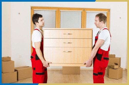 2 men lifting chest of drawers